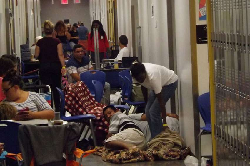 People bed down in the hallways of Largo High School in Largo, Fla., as they await Hurricane Irma Sept. 10.