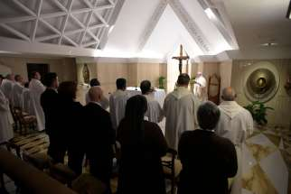 Pope Francis celebrates morning Mass in the chapel of his residence at the Vatican Jan. 30.