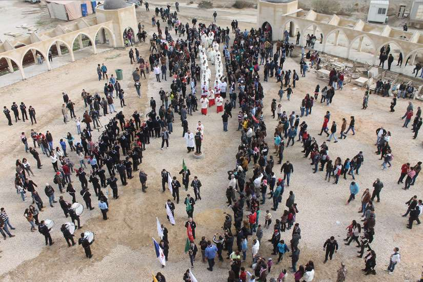 People join in a procession outside the Catholic Church of the Baptism of the Lord in Amman, Jordan, Jan. 16.