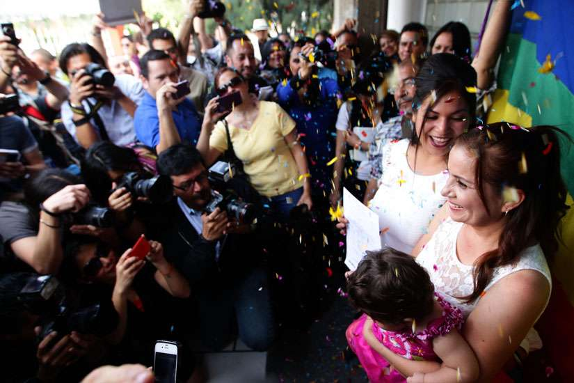 In this Dec. 14, 2013 file photo, a same-sex couple marries in Jalisco, Mexico.