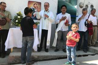 Mexican Coadjutor Bishop Enrique Diaz Diaz of San Cristobal de Las Casas blesses a new shelter for migrants Feb. 27 on the Mexico-Guatemala border. The shelter will house families seeking asylum in Mexico.