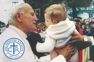 Pope John Paul II greets one of the young fans during his first visit to Canada in 1984.