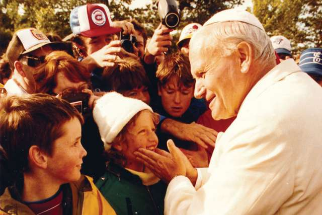 These children were among 350,000 people at Martyr's Shrine for Pope John Paul II's visit in 1984.