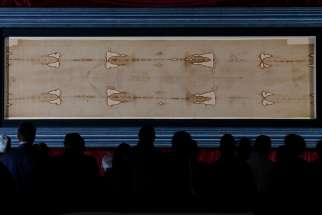 The Shroud of Turin is displayed at the Cathedral of St. John the Baptist in Turin, Italy, in 2015. St. Isidore's parish in Ottawa will host the Man of the Shroud exhibit, with a replica of the Shroud, during Passion week.