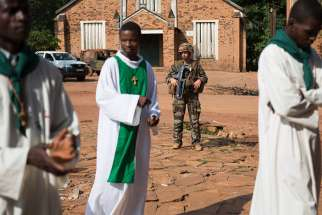 A French soldier stands guard at St. Joseph Cathedral in Bambari, Central African Republic, July 27, 2014. Two remote Catholic missions were raided by former militants in Diocese of Bouar April 4.