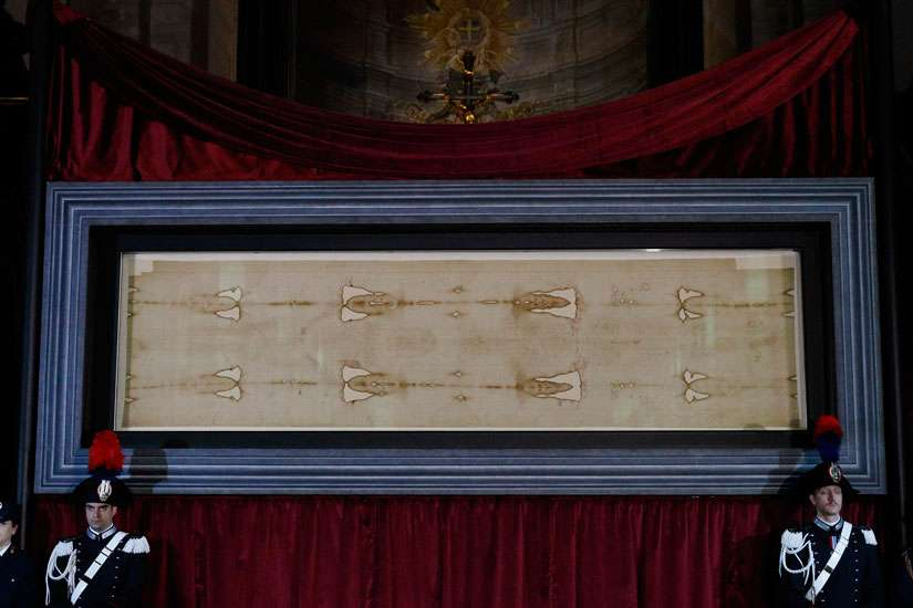 The Shroud of Turin is displayed during a preview for journalists at the Cathedral of St. John the Baptist in Turin, Italy, April 18. A public exposition of the shroud, believed by many to be the burial cloth of Jesus, runs from April 19 through June 24, 2015.