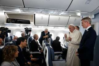 Pope Francis answers questions from reporters aboard his flight from Tokyo to Rome Nov. 26, 2019.