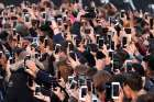 People use their smartphones to take photos in Paris, France, Oct. 1, 2017.