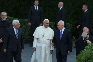 Palestinian President Mahmoud Abbas, Pope Francis, Israeli President Shimon Peres and Ecumenical Patriarch Bartholomew of Constantinople arrive for an invocation for peace in the Vatican Gardens June 8. Also pictured is Franciscan Father Pierbattista Piz zaballa, head of the Franciscan Custody of the Holy Land, far left.