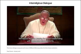 This screen capture shows Pope Francis reading a prayer message in a video released on the website, http://thepopevideo.org, Jan. 6. In the video, which features Catholics, Buddhists, Jews and Muslims, the pope called for dialogue among religions. The pope plans to release a monthly video prayer message on the site during the Holy Year of Mercy.