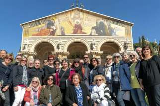 The MOSAIC Canadian Vocal Ensemble and the St. Michael's Choir School alumni choir pose in front of the Church of All Nations in Jerusalem during their Holy Land tour.