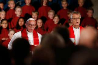 Pope Francis and the Rev. Martin Junge, general secretary of the Lutheran World Federation, attend an ecumenical prayer service at the Lutheran cathedral in Lund, Sweden, Oct. 31.