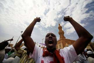 Sudanese demonstrators leave a Khartoum mosque after Friday prayers in this picture dated Sept. 14. Sudanese Christians have condemned the sentencing of a Christian woman to death by hanging after she married a Christian man.