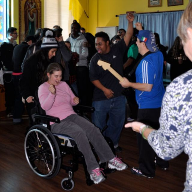 Grade 10 students from St. Jean de Brebeuf Catholic High School dance with special needs clients at St. Jude's Academy of the Arts.