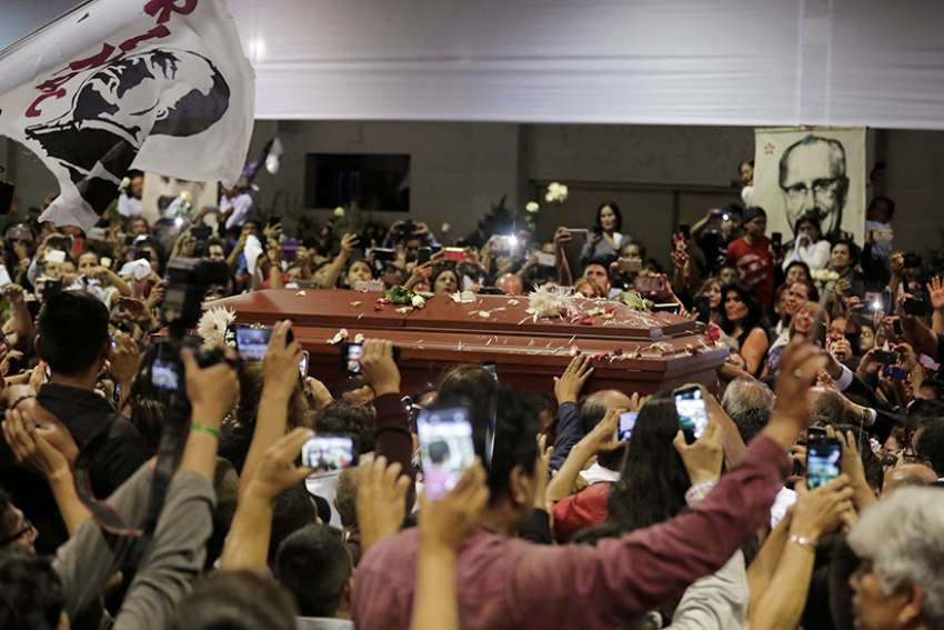 People react as the coffin holding the body of former Peruvian President Alan Garcia arrives at the APRA party headquarters April 18, a day after he died of a gunshot wound believed to be self-inflicted.