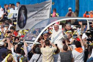 Pope Francis greets the crowd before celebrating Mass at Monza Park near Milan March 25.