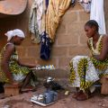 Twins Hawa and Adama Keita, 15, warm a pot of tea in late November outside an area where 15 other family members rent rooms in a suburb of Bamako, Mali. More than 200,000 Malians have migrated to the south since a March 2012 military coup, while a simila r number have fled to Niger, Burkina Faso, Morocco and Algeria.