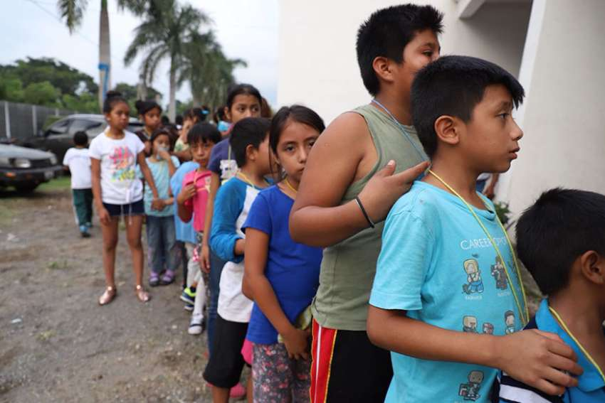 Children wait in line at a shelter in Escuintla, Guatemala, June 4. The eruption of the nearby Volcano of Fire a day earlier killed at least 69 people.