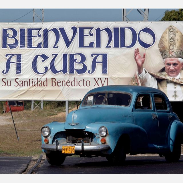 A car drives past a Havana billboard welcoming Pope Benedict XVI to Cuba. Pope Benedict will visit Cuba March 26-28.