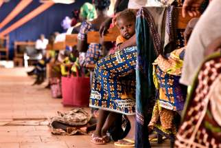 Displaced Christians attend a church service in Kaya, Burkina Faso.