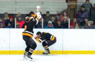Fr. John Perdue launches a surprise at a teammate and an unsuspecting audience during a charity game in Mattawa, Ont.
