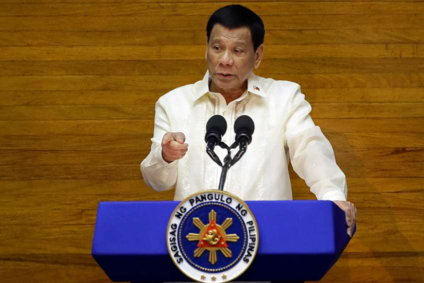 Philippine President Rodrigo Duterte delivers his State of the Nation address July 23 at the House of Representatives in Manila. Religious leaders and activists say human rights are dying under Duterte's rule.