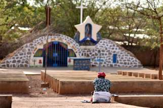 A displaced Christian woman prays in front of a grotto with a statue of Mary in Kaya, Burkina Faso, May 16, 2019. Hundreds of thousands of people have been forced out of their homes in Burkina Faso as Christian communities are targeted in a spiral of Islamist killings.