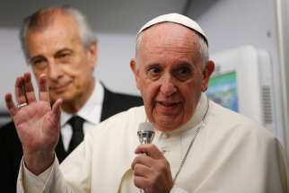 Pope Francis answers questions from journalists aboard his flight from Asuncion, Paraguay, to Rome July 12.