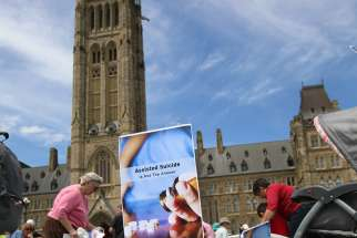 "Opponents of euthanasia and assisted suicide staged a ""die-in"" following a rally on Parliament Hill in Ottawa, Ontario, in early June 2016."