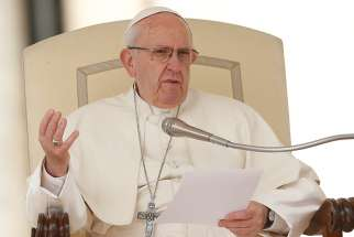 Pope Francis delivers his talk during his general audience in St. Peter's Square at the Vatican March 28.