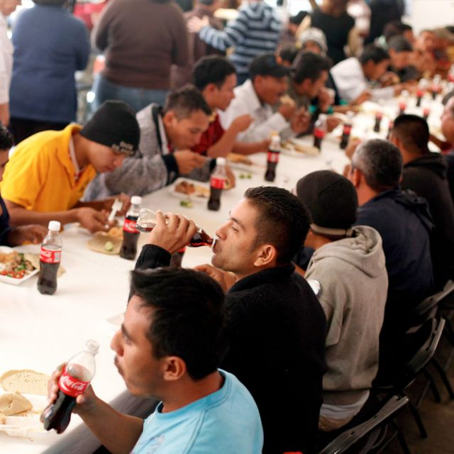 Migrants eat at the St. Juan Diego migrant shelter in Tultitlan, Mexico, Jan. 20. A new Pew Hispanic report shows that fewer Mexicans are entering the U.S. -- down by about half, from 3 million to 1.4 million -- and more are returning to their homeland -- nearly doubling in the five-year period of 2005-2010 to almost 1.4 million, from 667,000 the previous five years.
