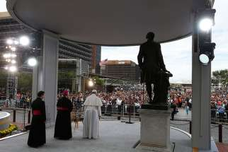 Pope Francis looks out to the crowd as he arrives to give an address from Independence Hall in Philadelphia Sept. 26.