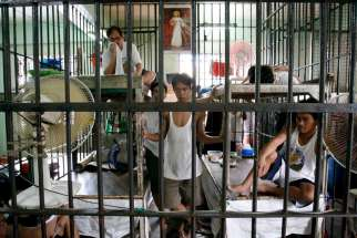 Filipino inmates share a cell at a jail facility in Manila, Philippines, in this April 17, 2006, file photo. Combating radicalization in prisons will be addressed at a May 30-June 1 gathering in Strasbourg, France.