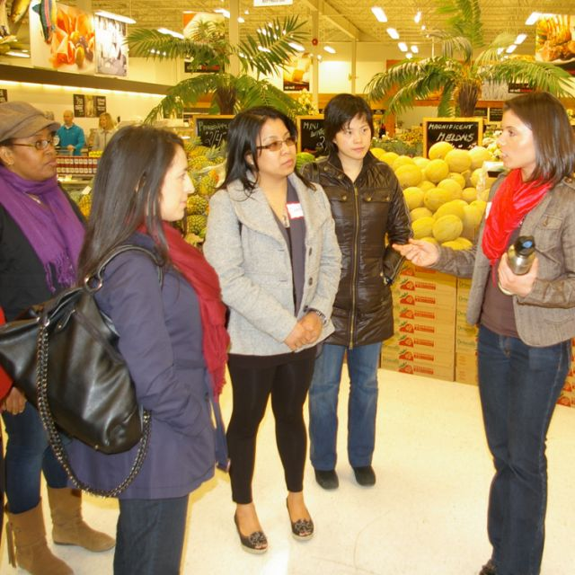 Registered dietitian Ashley Nicholas speaks to participants on the grocery tour of Loblaws at Faith Connections' Keeping the Temple Healthy event.