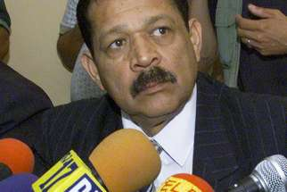 Salvadoran Col. Inocente Orlando Montano is pictured during a 2000 news conference denying involvement in the 1989 deaths of six Jesuit priests, their housekeeper and her daughter.