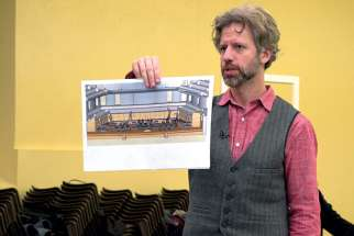 Joel Ivany, stage director, holds up a sketch of his semi-staged production of Mozart's Requiem during rehearsals. Ivany promises the performance will be a dramatic and engaging experience.