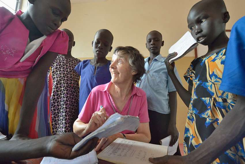Irish Loreto Sister Rosemary Gallagher, who teaches at Loreto Primary School in Rumbek, South Sudan, works with students in late April. The Loreto Sisters began a secondary school for girls in 2008, with students from throughout the country, but soon after added a primary in response to local community demands.