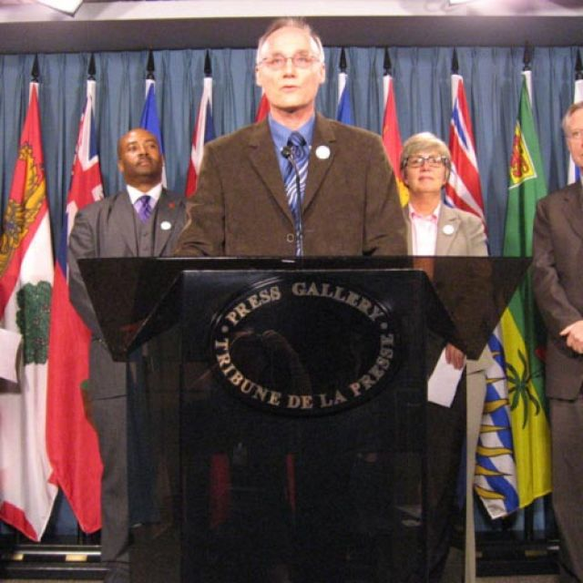 Citizens for Public Justice executive director Joe Gunn releases Poverty Scorecard Oct. 17. Members of the All-Party Anti- Poverty Caucus and the head of Canada Without Poverty joined him.