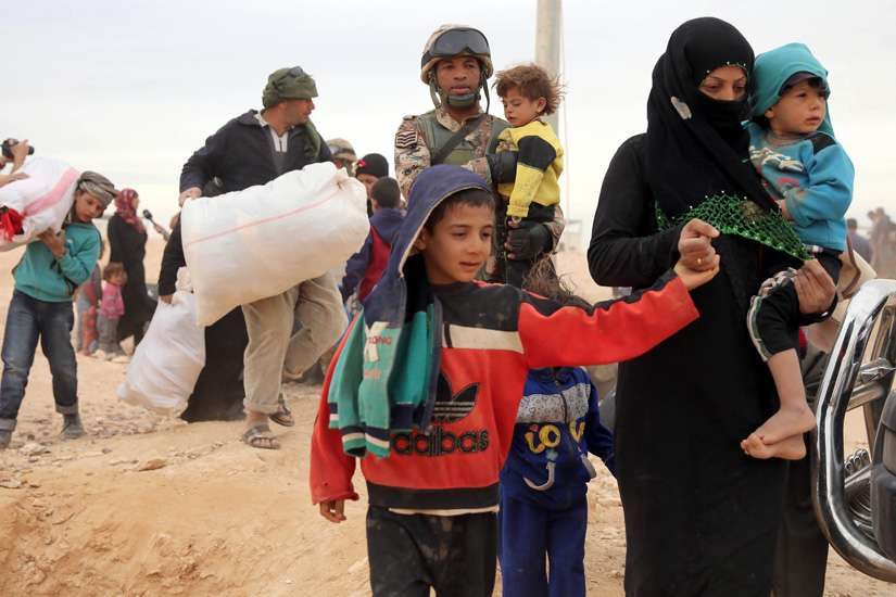 Syrian refugees arrive at a refugee camp in early May at the Jordan border with Syria. The Catholic Church in England and Wales has joined a government project to resettle an estimated 20,000 refugees from the Syrian war.