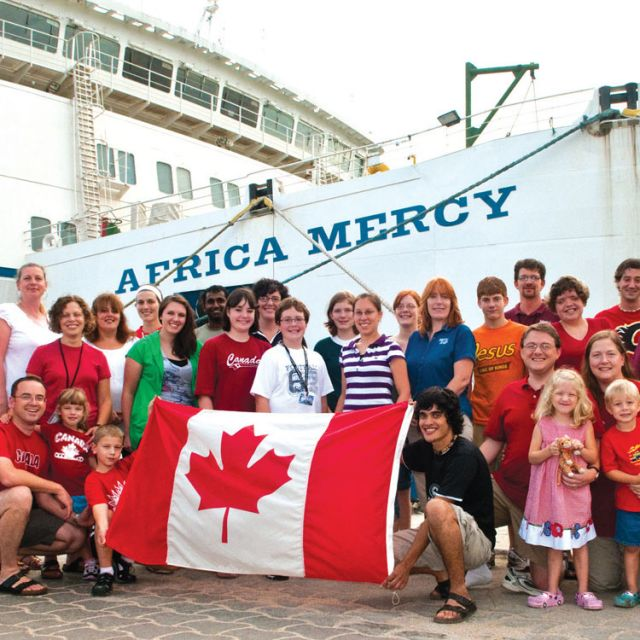 Some of the 134 Canadians who volunteered aboard the Africa Mercy in 2012 pose for a photo while docked in a port in Guyana.