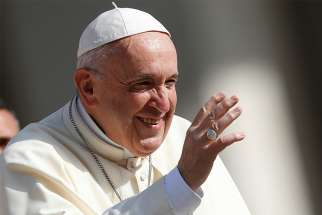 Pope Francis greets the crowd during his general audience in St. Peter's Square at the Vatican April 25.
