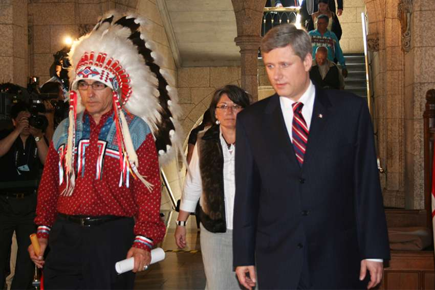 Assembly of First Nations Chief Phil Fontaine and Prime Minister Stephen Harper on June 11, 2008, when Harper made an historic apology for the government's role in Indian residential schools.