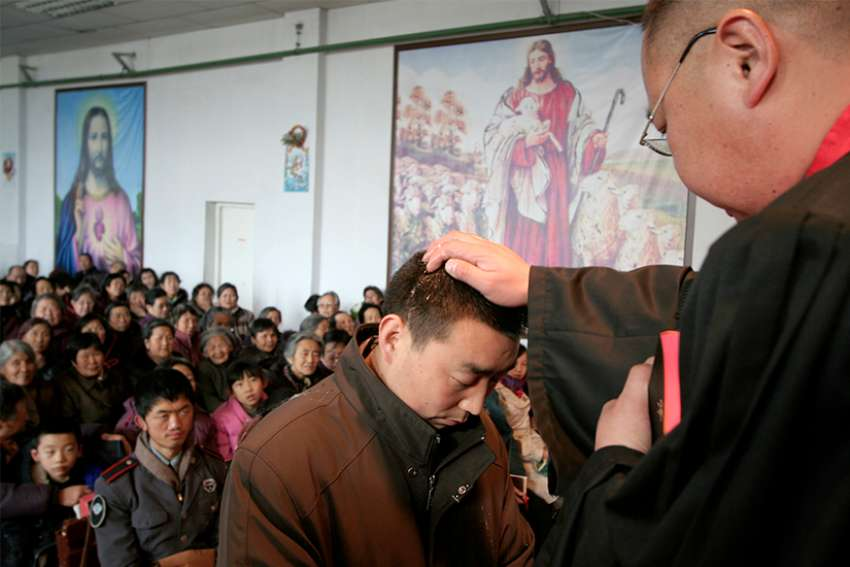 he Catholic Church in China registered 48,556 baptisms in 2017, according to a report by Fides, the news agency of the Congregation for the Evangelization of Peoples. In this Dec. 24, 2006, file photo, a man is baptized during a Christmas Eve Mass on the outskirts of Xining in northwestern China's Qinghai province.