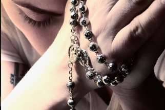 Stefani Germanotta, known as Lady Gaga, posted a photo on social media of herself praying the rosary on Sept. 18.