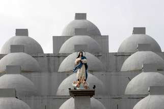 A statue of Mary is seen in 2017 atop the Cathedral of Managua in Nicaragua. A 24-year-old woman dumped sulfuric acid on a priest while he was hearing confessions in the cathedra Dec. 5.