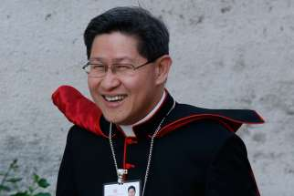 Cardinal Luis Antonio Tagle of Manila, Philippines, arrives for the opening session of the extraordinary Synod of Bishops on the family at the Vatican Oct. 6.
