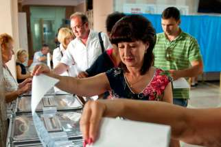 Ukrainians vote in the parliamentary elections in Sevastopol, Ukraine, Sept. 14. Millions of Ukrainians will go to the polls Oct. 26 to elect new members of parliament; all 450 seats were up for renewal.