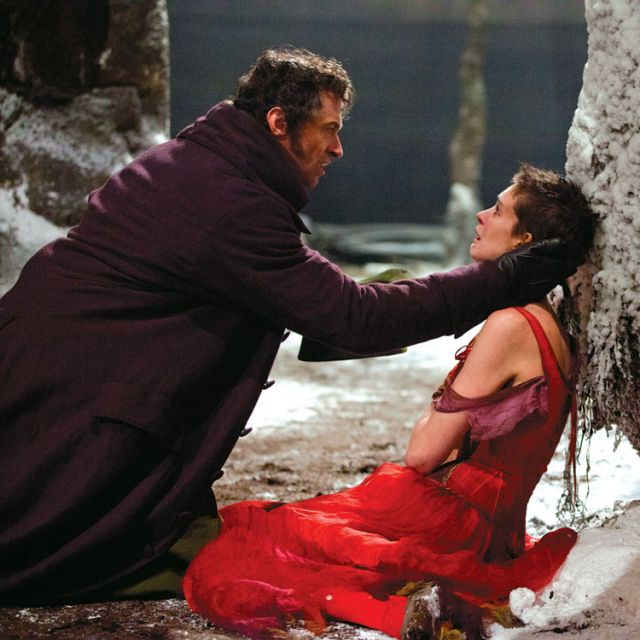 Hugh Jackman and Anne Hathaway star in a scene from Les Miserables, the big-screen adaptation of the long-running stage show.