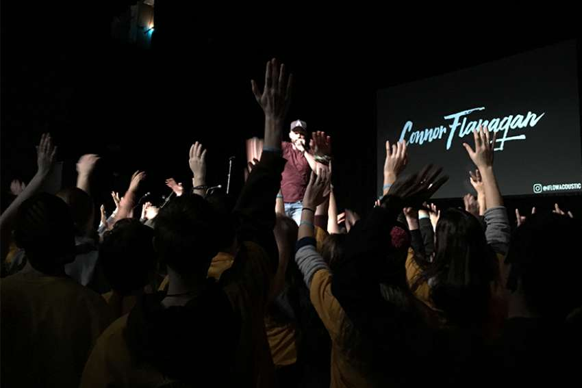 Connor Flanagan pumps up the youth with some praise and worship music at the 2018 Lift Jesus Higher Rally in Toronto.