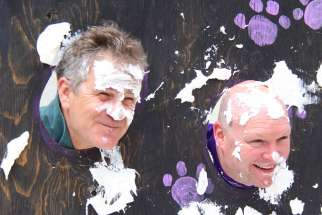 On the school's feast day celebration, St. Joseph school principal Jeff Quinneville, left, and teacher Bo Pryszlak invited students to throw pies at their faces with donations in support of ShareLife.